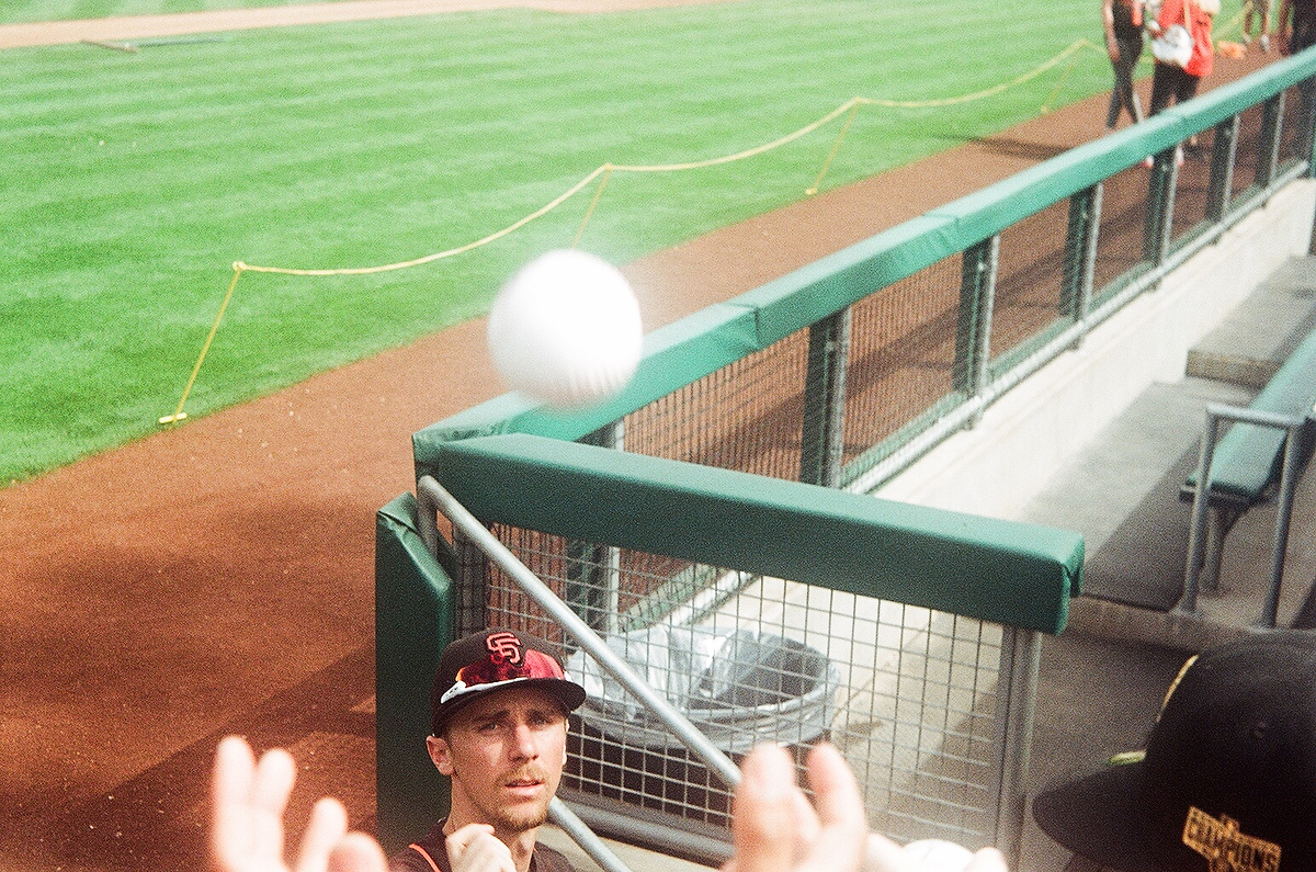 Duffy tosses a signed ball to a young fan before the game.